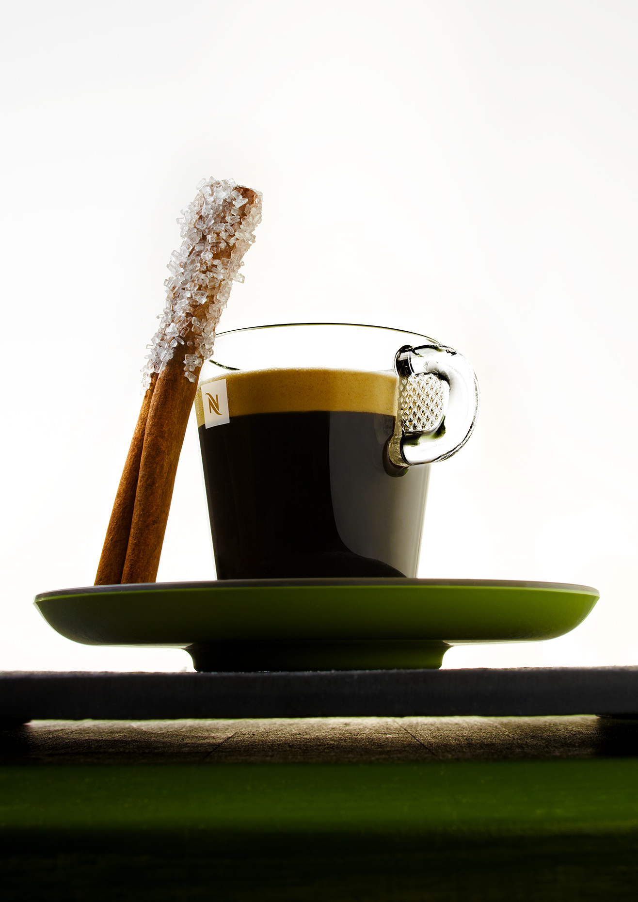 Espresso-With-Cinnamon-Stick-On-Green